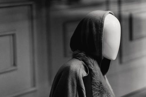 Mannequin in elegant outerwear in showcase
