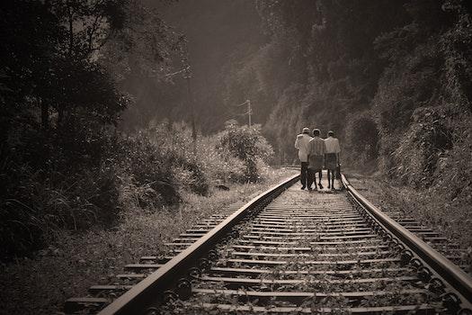 People Walking on Railroad Tracks