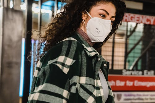 Lady in mask in subway station