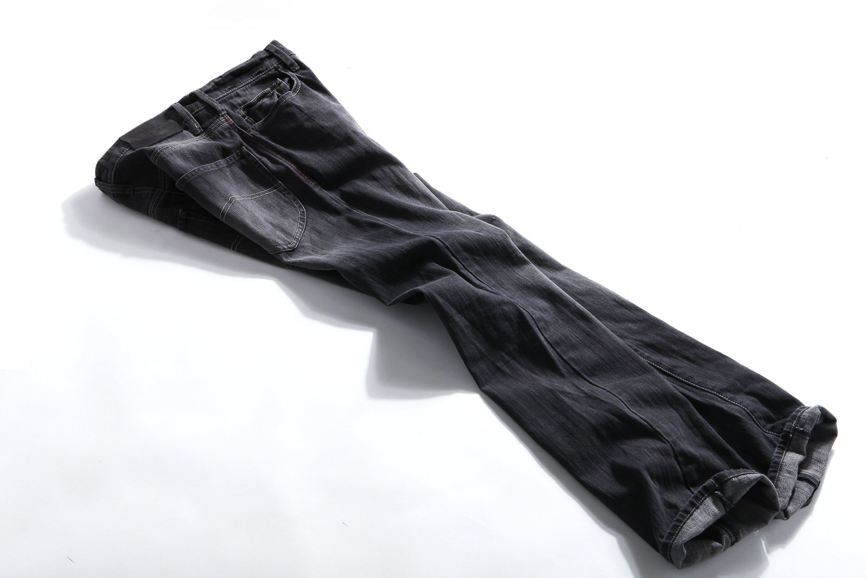 Black Denim Jeans on White Panel