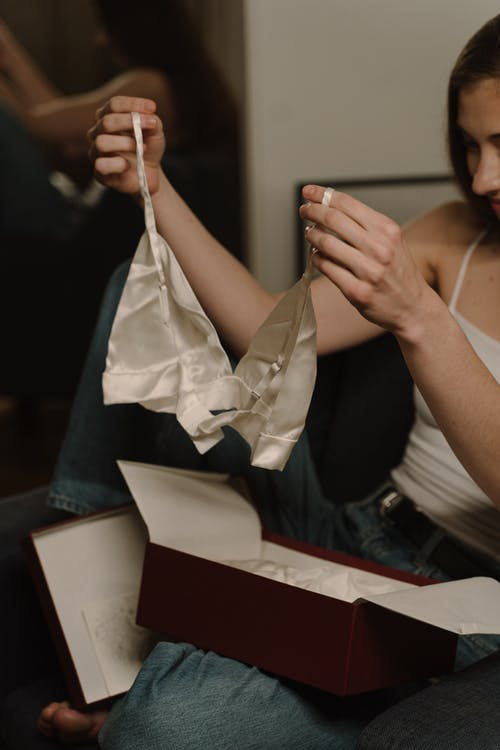 Woman in White Tank Top Holding White Paper