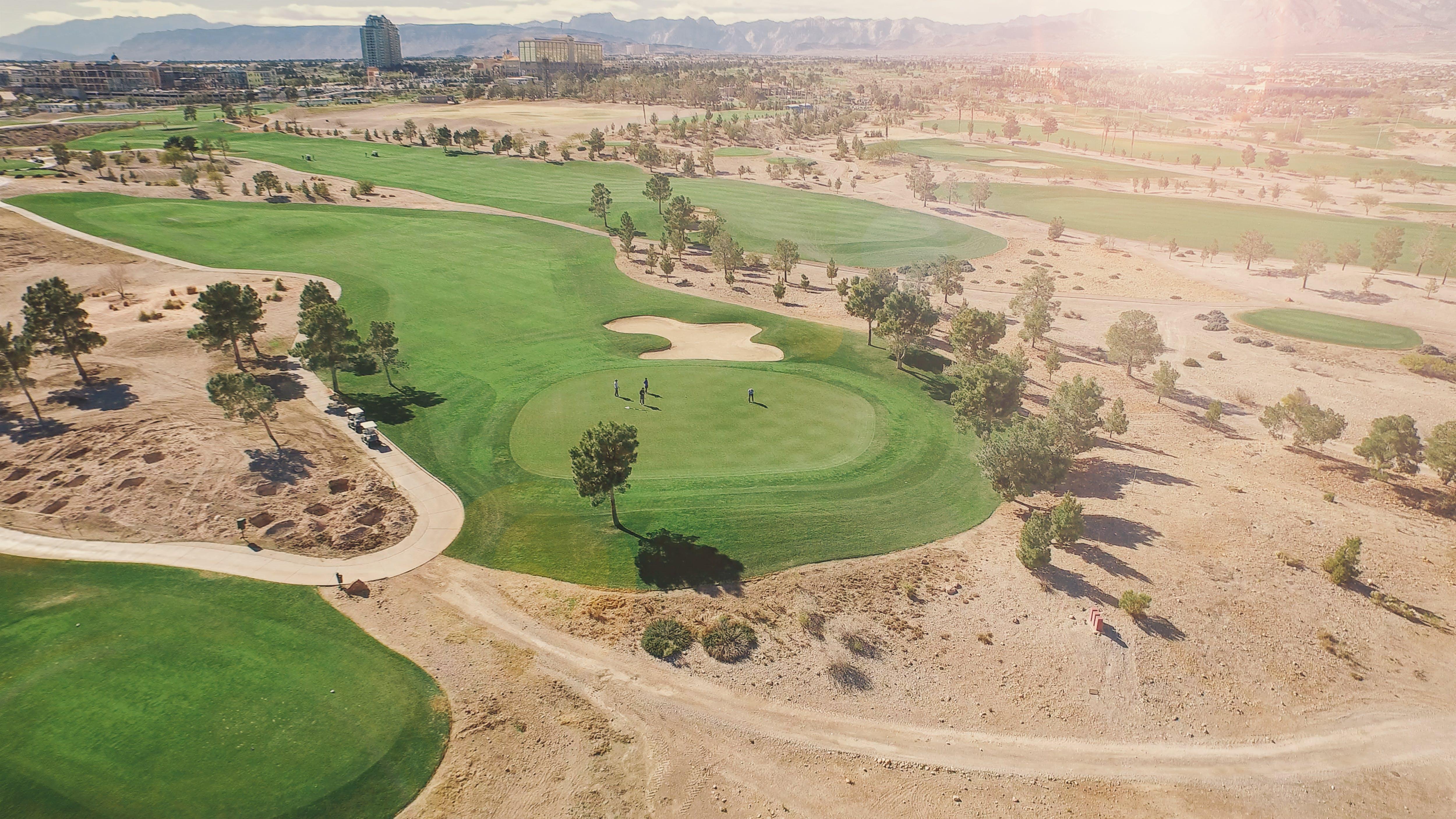 Golf Course Under Sunny Sky