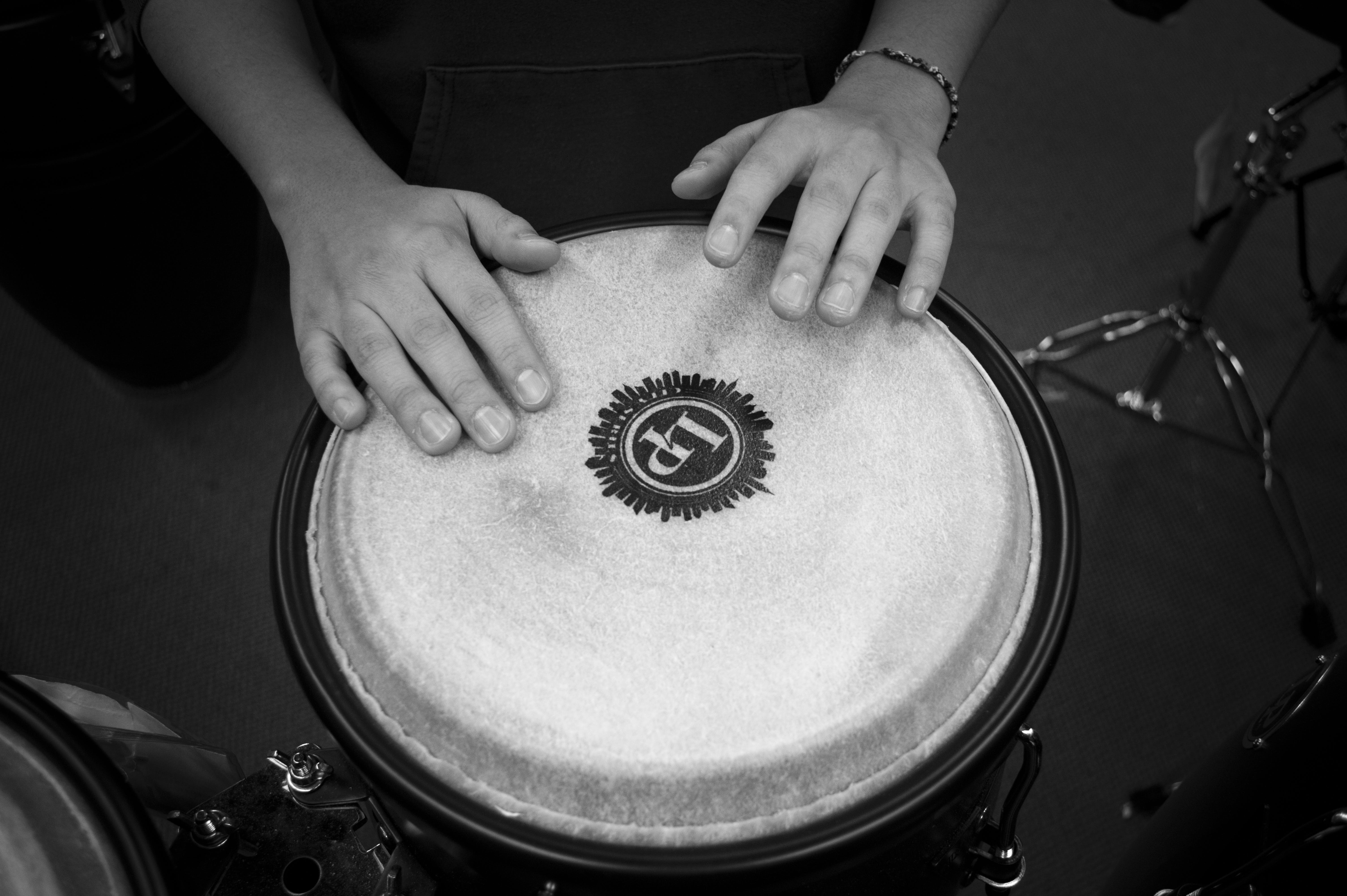 Person Holding Drums