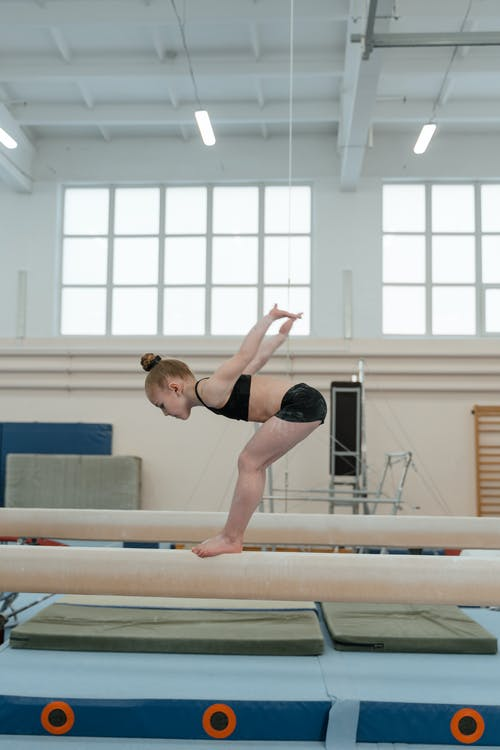 Little Gymnast Practicing Routine on Balance beam