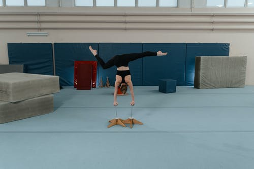 Person Doing Hand Stand on Contortion Equipment
