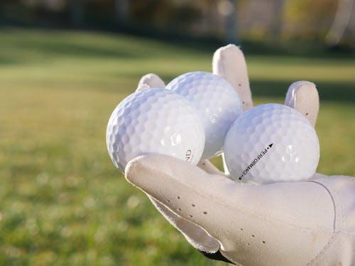 Three White Golf Balls
