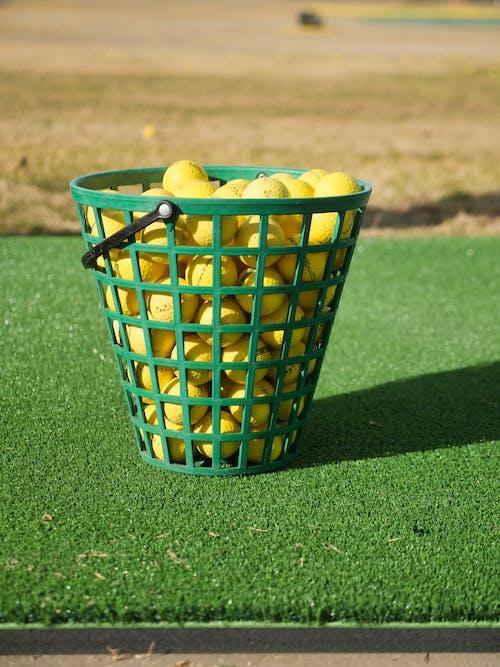 A Basket of Yellow Golf Balls