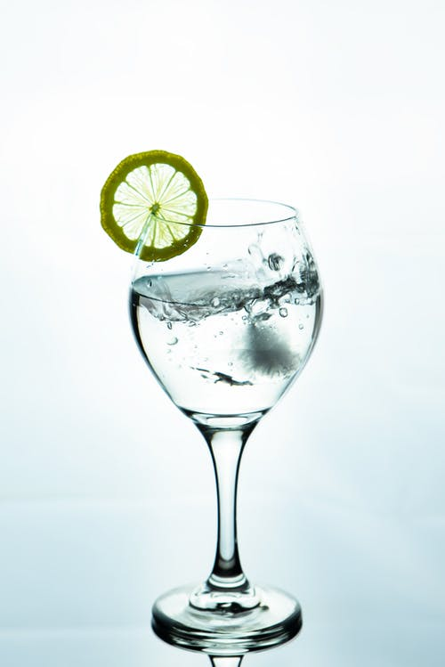 Clear Cocktail Glass With Sliced Lemon