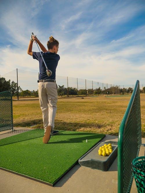 A Boy Finish Position of Golf Swing