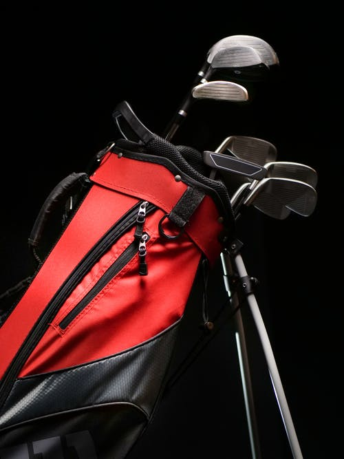 A Red and Black Caddy Bag with Club Set