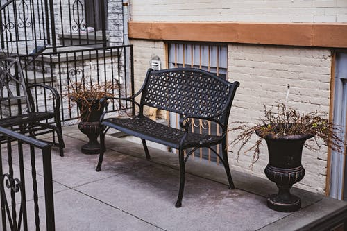 Black Metal Bench Beside the Potted Plants