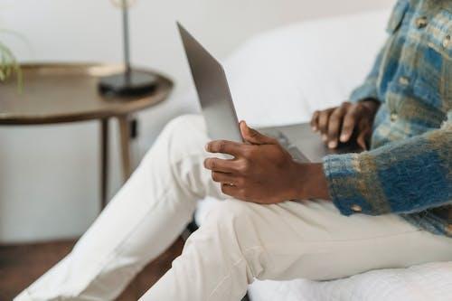 Ethnic man using touchpad on laptop