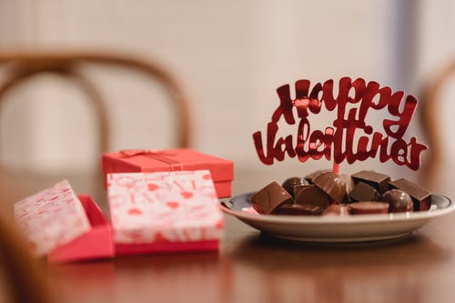 Small gift boxes with chocolates on table