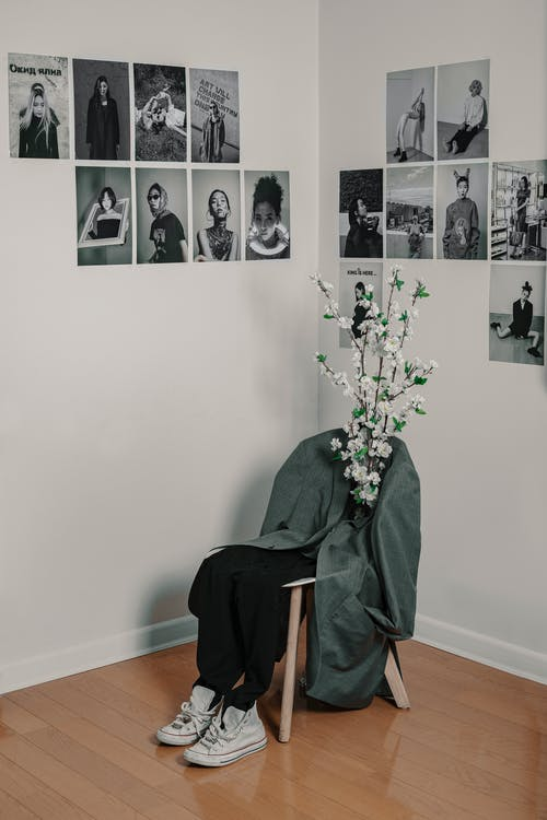 Chair with clothes and flowers in building