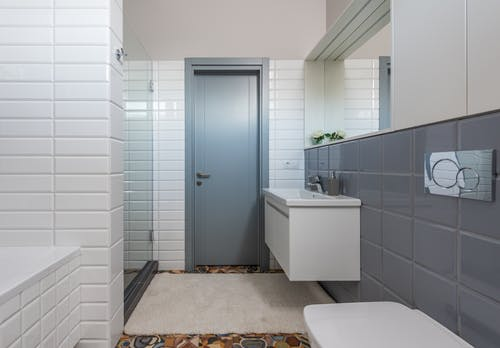 Interior of contemporary bathroom in white and gray colors