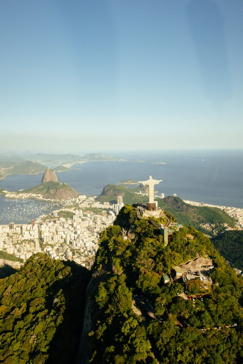 Aerial view of sculpture of Jesus Christ on green mount in Rio de Janeiro Brazil on summer day