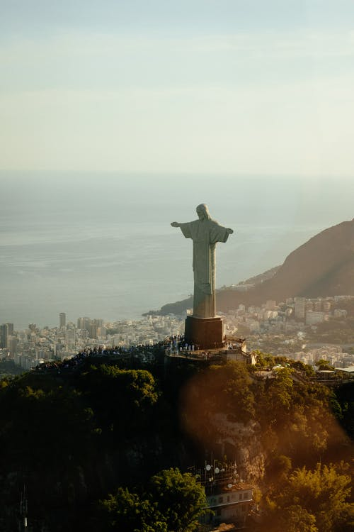 Statue of Jesus Christ on mount in evening
