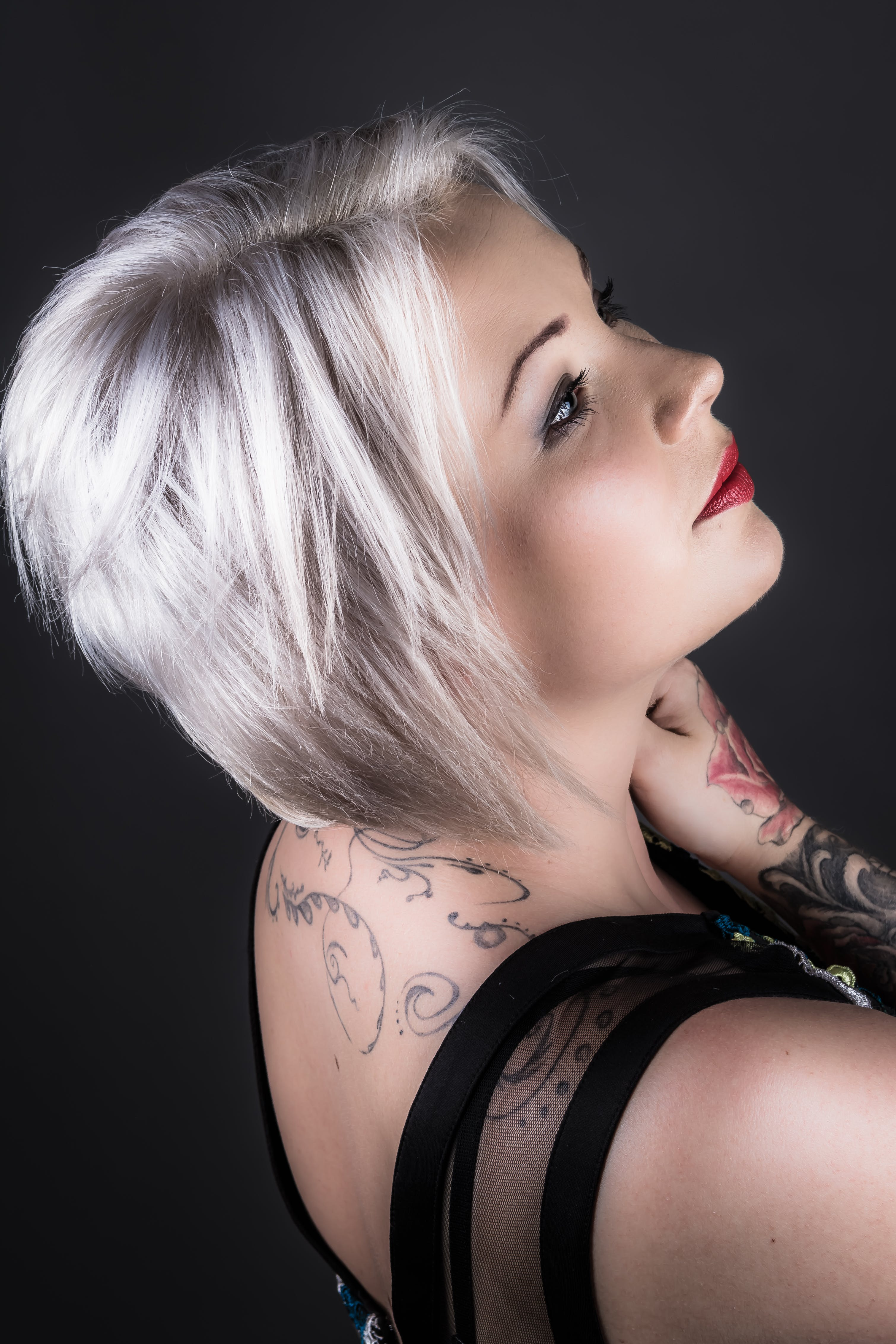 Woman Wearing Black Shirt With Tattoo and Red Lipstick