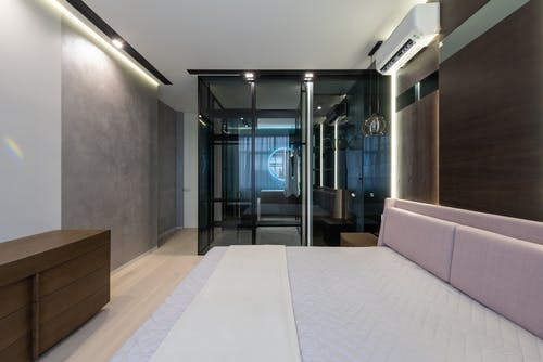 Bathroom with glass wall in cozy bedroom