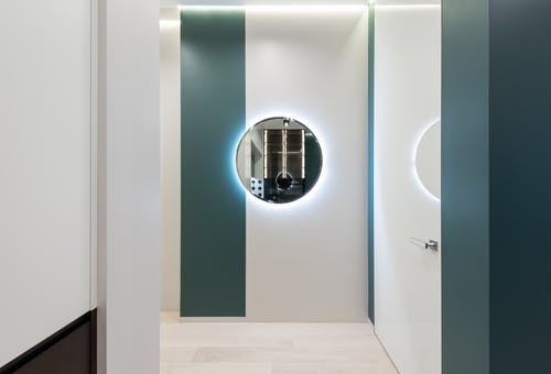 Hall of contemporary apartment with round mirror