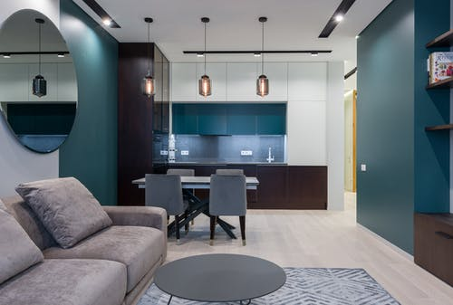 Interior of contemporary apartment with comfortable furniture in living room and kitchen in daylight