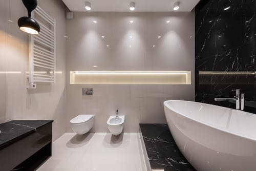 Bathroom interior with white and black tile