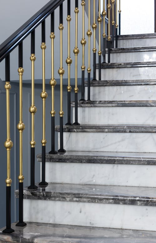 Classic staircase with metal banister in house