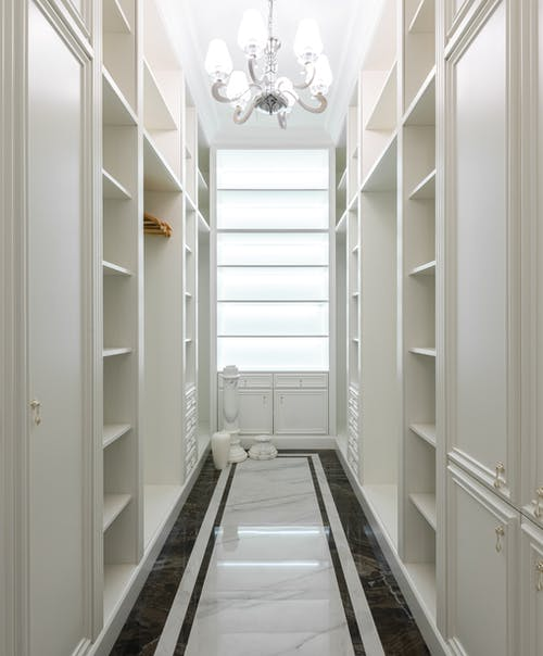 Empty shelves of modern wardrobe at home