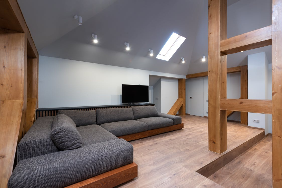 Large lounge with soft sofa under window on ceiling