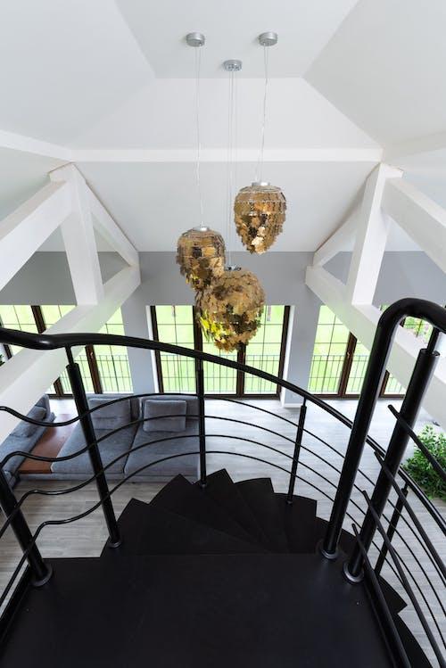 Golden shimmering lamps hanging on ceiling
