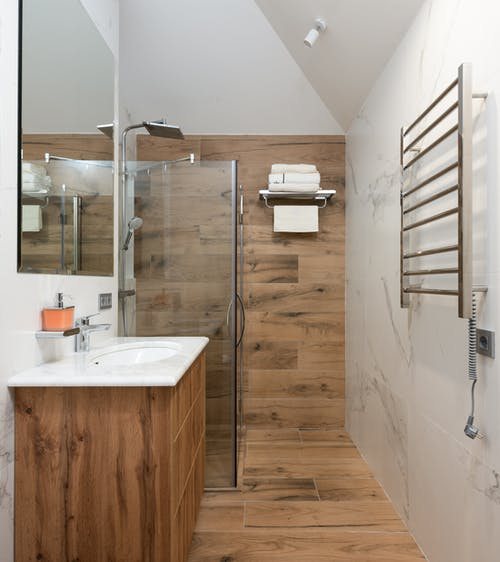 Modern bathroom with white clean sink and timber walls