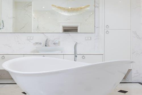 Oval shaped white bathtub in contemporary bathroom