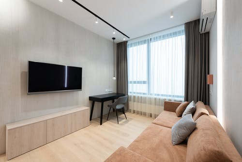 House interior with couch in front of TV near table