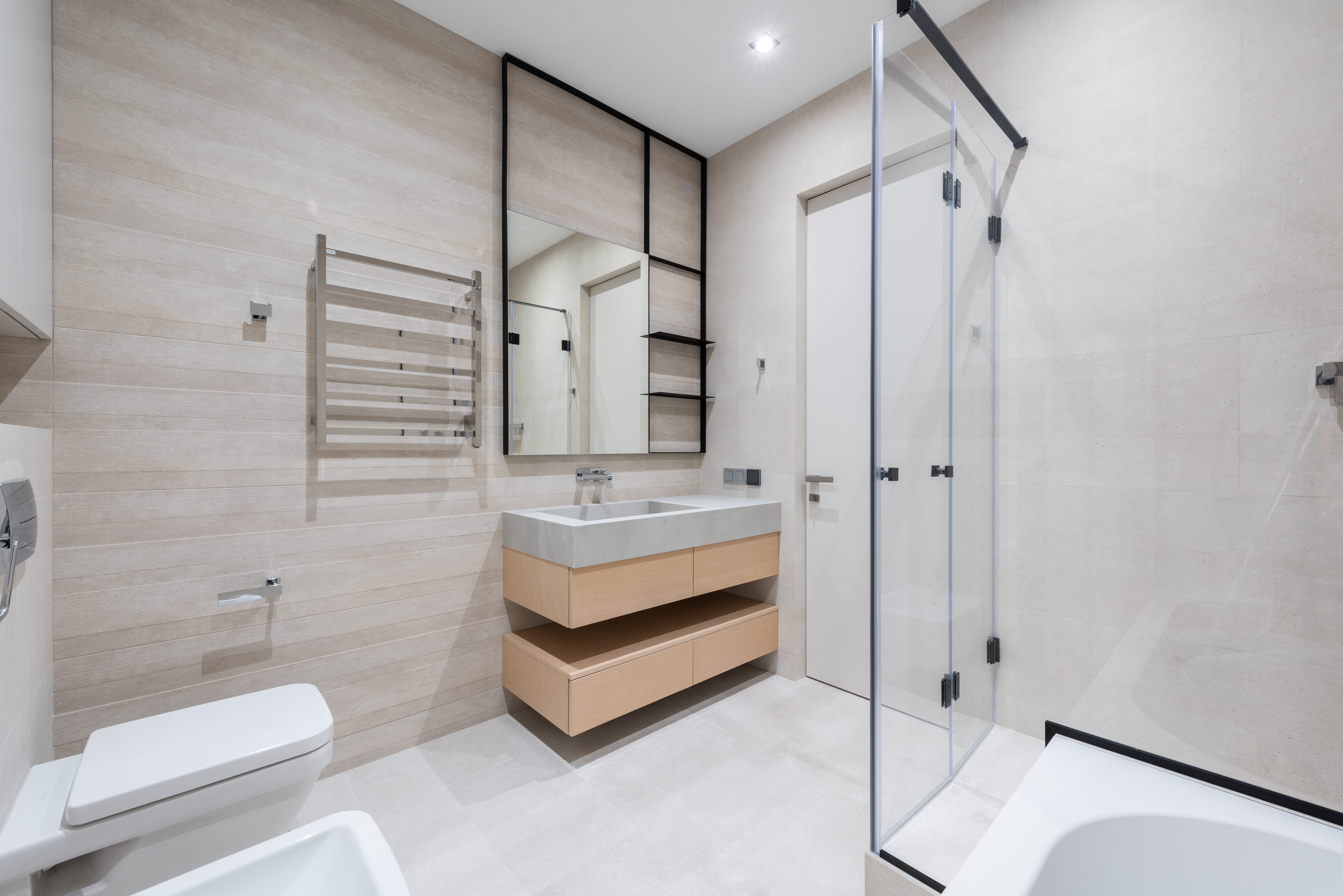 bathroom with toilet and bathtub near sink on counter