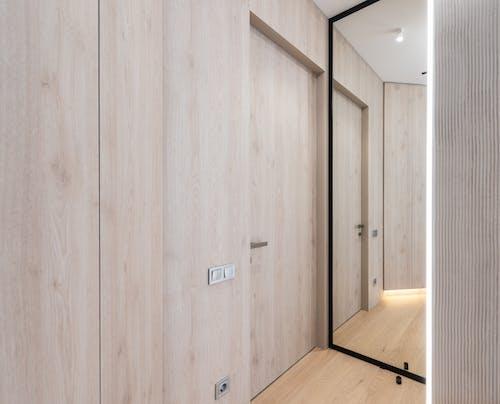 Hallway with door and mirror in house