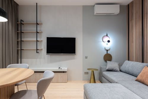 Stylish living with sofa and modern TV