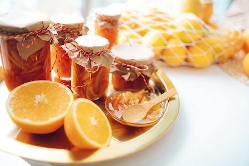 Kostnadsfri bild av apelsinjuice, bord, citron, färg