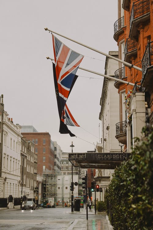 Photo of United Kingdom Flag Hanging on a Building