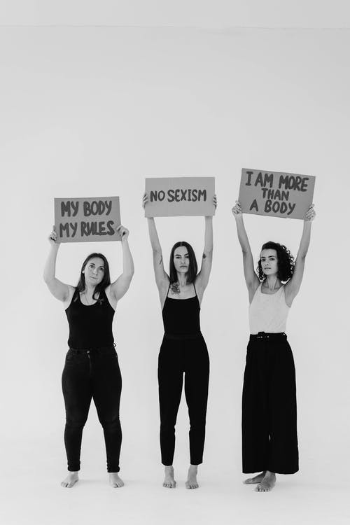 Women Holding Signboards