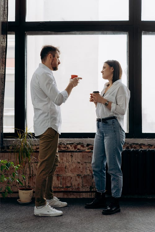 A Man and Woman Talking Wearing White Long Sleeve