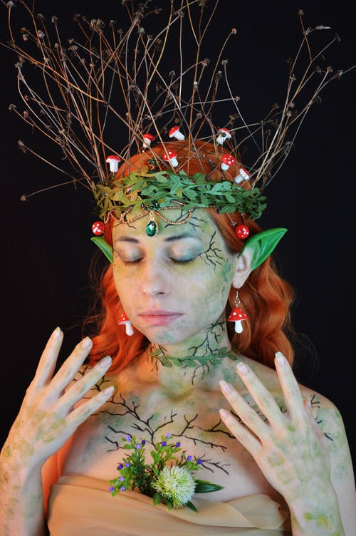 Woman With Green and Red Flower Headdress
