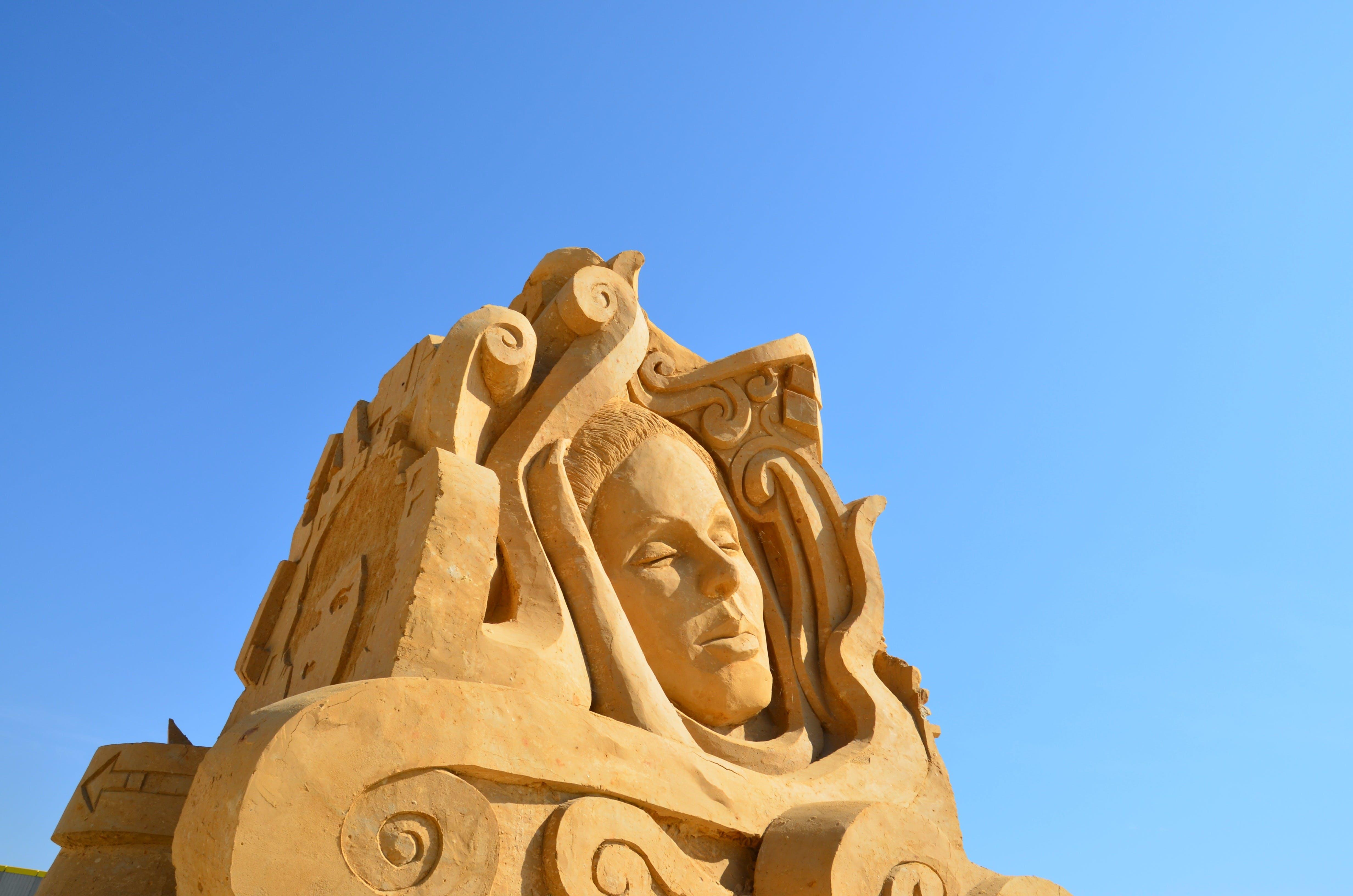 Female Sand Sculpture during Daytime