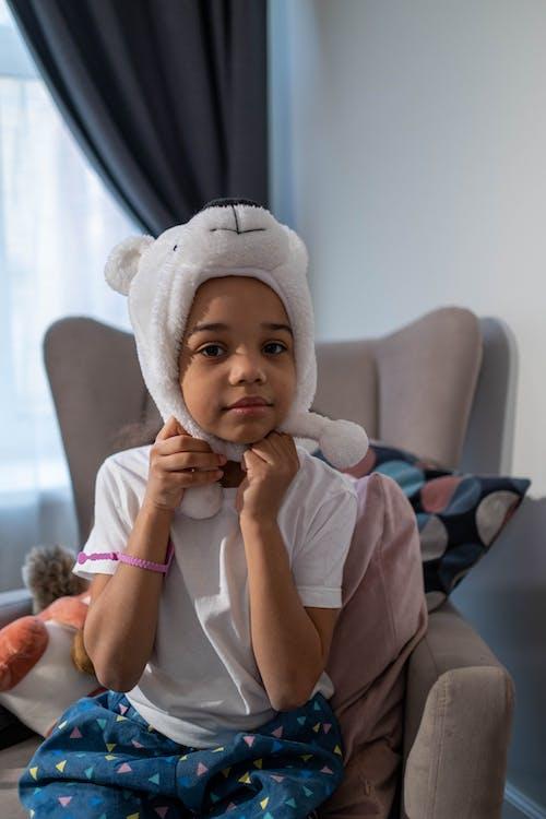 A Girl Wearing an Adorable Headwear