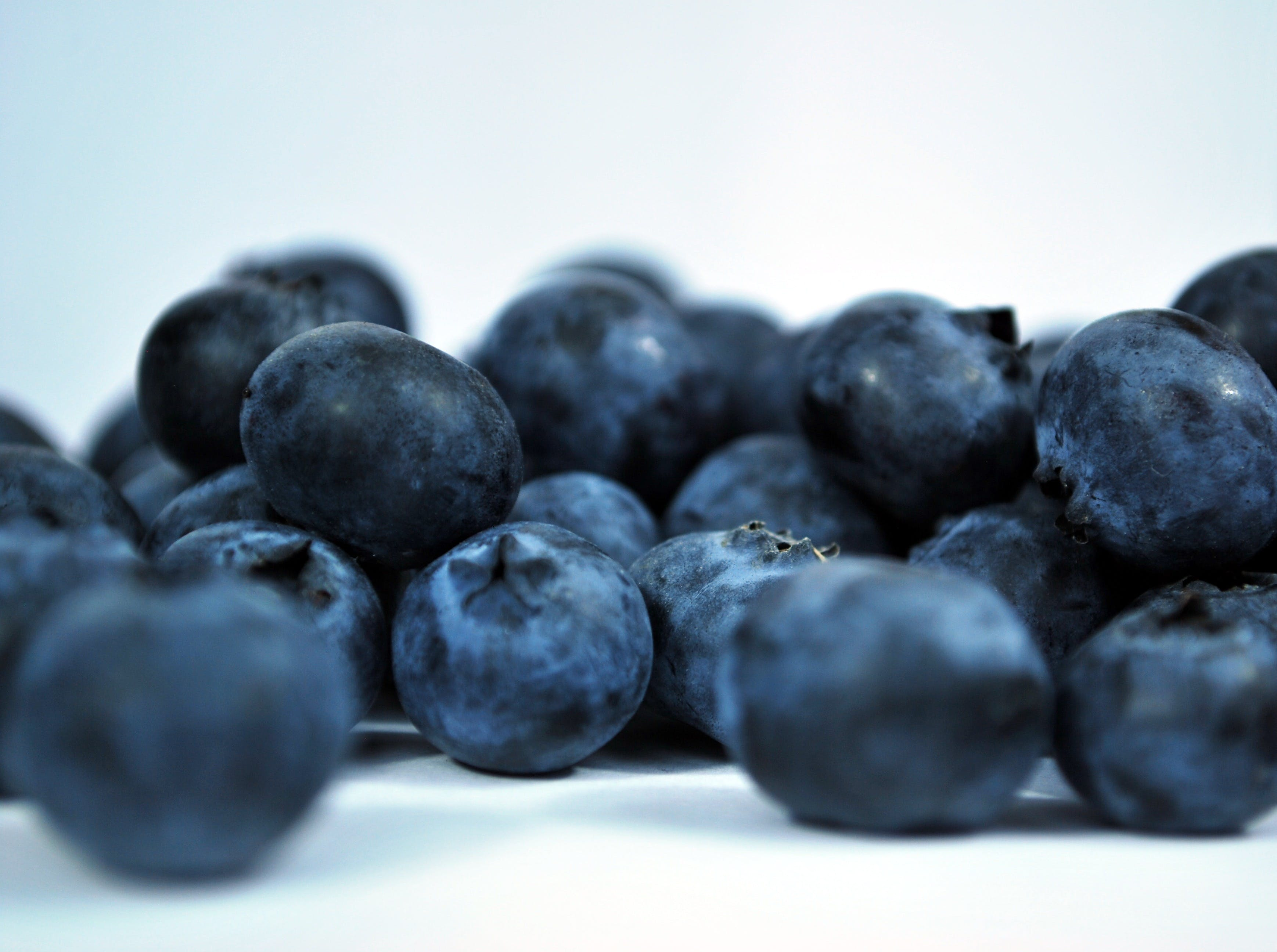 Shallow Photography of Blueberries