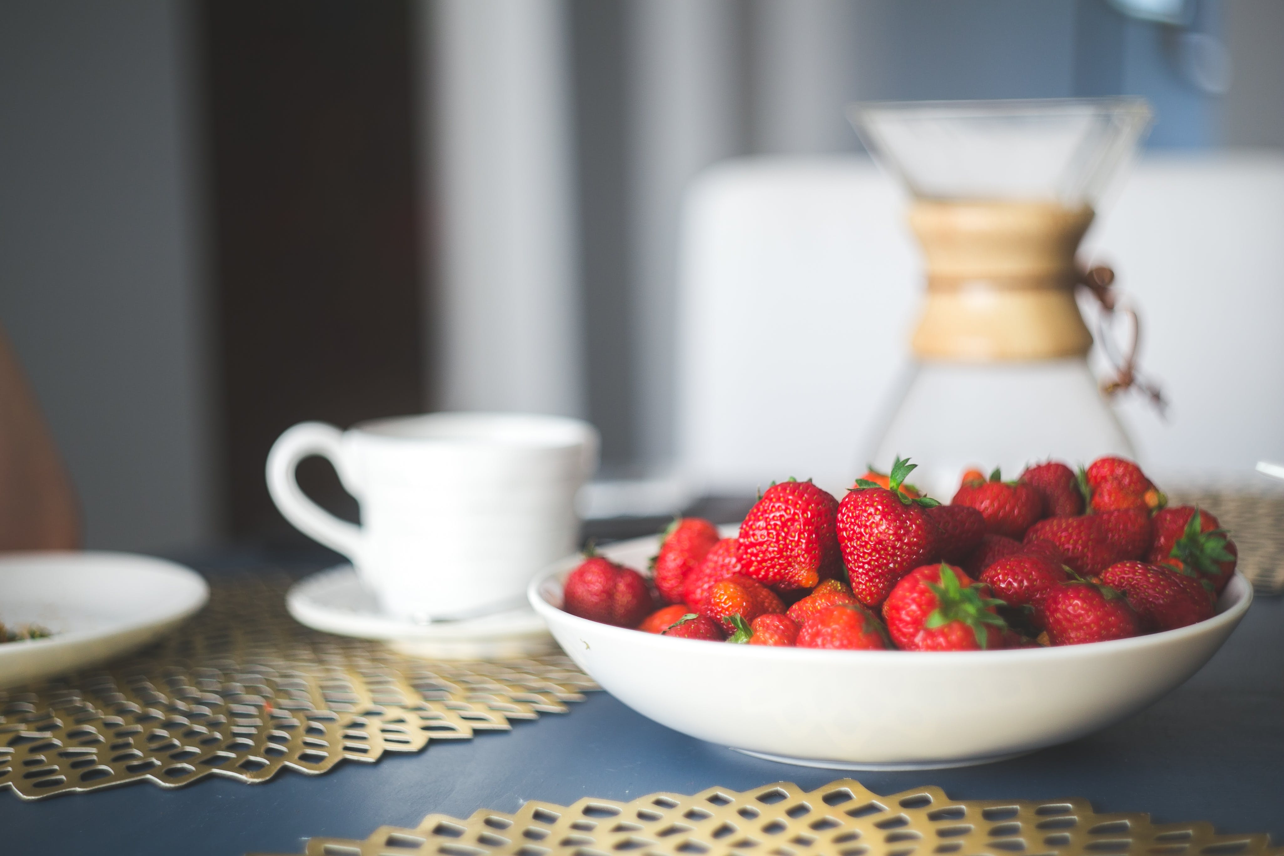 Fresh organic strawberry in white bowl