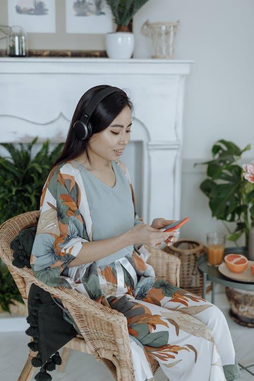A Woman Wearing a Headphone