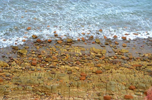 Brown Rocks on Seashore