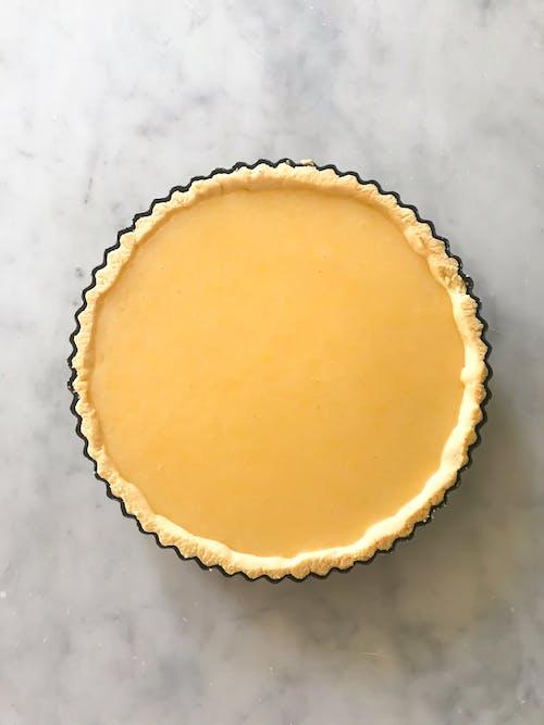 Lemon tart on marble table