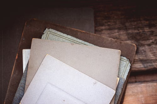 White Paper on Brown Wooden Table