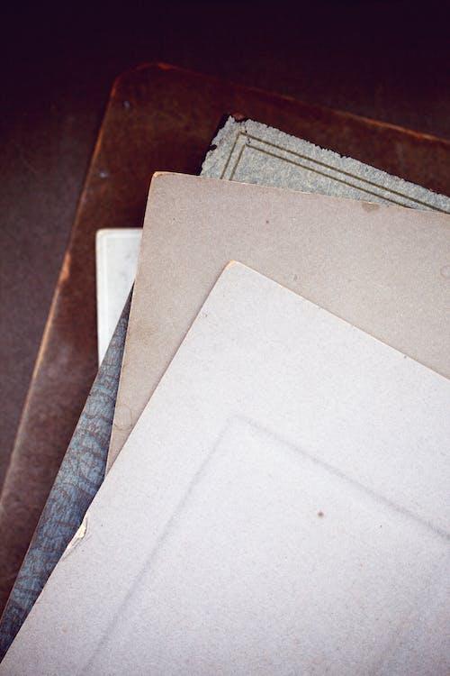 White Printer Paper on Blue Denim Jeans